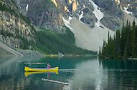 Canoeist paddling on Moraine Lake, Banff National Park Alberta Canada