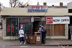16 Jan, 2006. New Orleans, Louisiana. Post Katrina.<br />  Local PNT Supermarket in the Marigny neighbourhood re-opens as small businesses slowly return to the city.<br /> Photo; Charlie Varley/varleypix.com