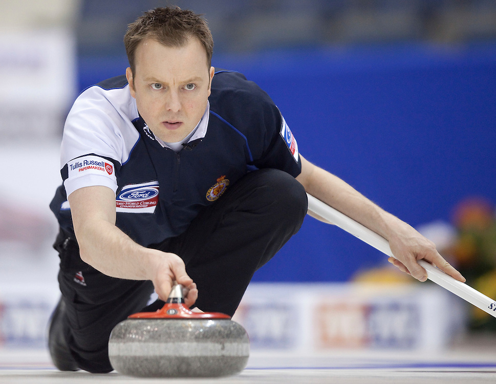 Scottish skip Tom Brewster delivers a stone during his match against the United States at the World Curling Championships at the Brandt Centre in Regina, Saskatchewan, April 7, 2011.<br /> AFP PHOTO/Geoff Robins