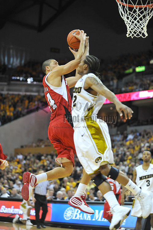 Jan 23, 2010; Columbia, MO, USA; Nebraska Cornhuskers guard Ryan Anderson (44) is fouled by Missouri Tigers guard Marcus Denmon (12) in the first half at Mizzou Arena in Columbia, MO.  Mandatory Credit: Denny Medley-US PRESSWIRE
