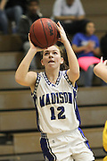 Caitlyn Ford puts up a shot during earlier season action.  Madison's Lady Mountaineers ended their post season play with a 31-25 lost at Altavista in the Region B Quarterfinals.  Date:  January/20/10, MCHS Varsity Girl's Basketball vs Fluvanna Flucos,