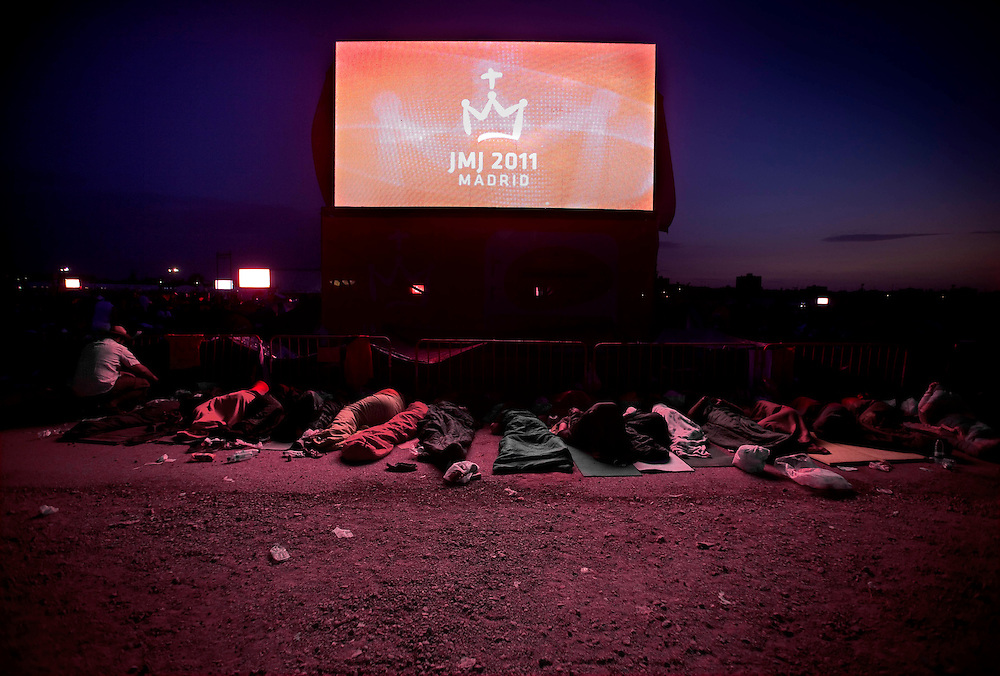 Pilgrims sleep on the ground at the Cuatro Vientos airbase in Madrid Sunday Aug. 21, 2011. An estimated one million pilgrims slept overnight at the base. The Pope Benedict XVI is in the Spanish capital of Madrid for a four-day visit on the occasion of the Catholic Church's World Youth Day.
