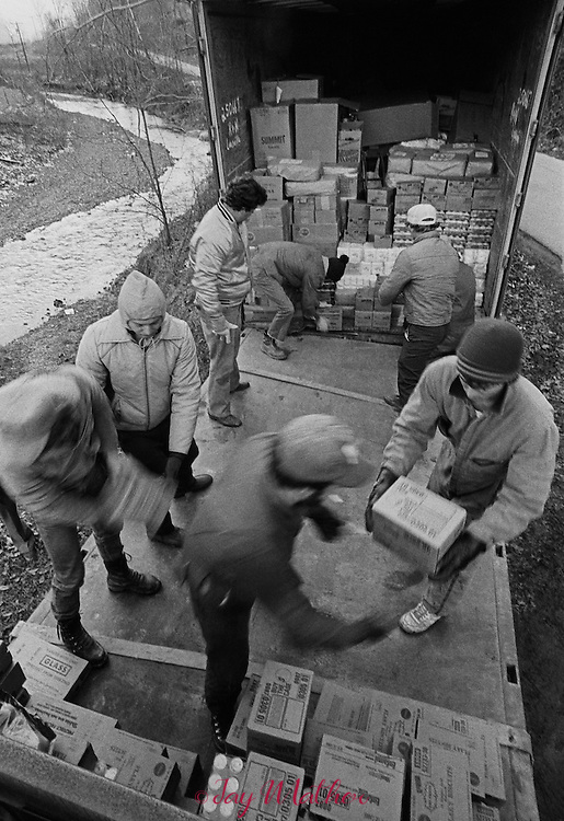 Residents in the Cranks Creek area in Harlan County, Kentucky dealing with low income, poverty and hunger.  The Cranks Creek Survival Center operated by Rebecca and Bobby Simpson helps with food and clothing donations.  Virgil Johnson, a former resident, working in Louisville organized a food drive and collected a trailer full of goods that he drove to the center for distribution.  .November 1985