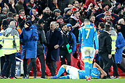 Liverpool Manager Jurgen Klopp and Napoli Manager Carlo Ancelotti shake hands amid dejected Napoli players and celebrating Liverpool fans at the end of the Champions League Group C match between Liverpool and Napoli at Anfield, Liverpool, England on 11 December 2018.