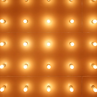 Theater lights symmetrical background pattern. Available as stock photo or print.
