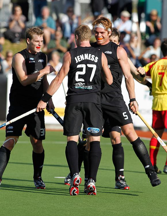 New Zealand's Andy Hayward, right, celebrates his goal with New Zealand's Stephen Jenness and Steve Edwards in a semi final match of the Hockey Champions Trophy, Auckland, New Zealand, Thursday, December 08, 2011.  Credit:SNPA / Ben Campbell
