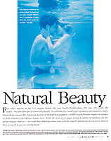 Editorial photo of couple kissing underwater.