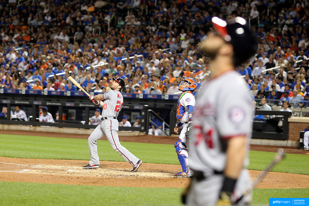 NEW YORK, NEW YORK - July 08: Daniel Murphy #20 of the Washington Nationals batting watched by Bryce Harper #34 of the Washington Nationals during the Washington Nationals Vs New York Mets regular season MLB game at Citi Field on July 08, 2016 in New York City. (Photo by Tim Clayton/Corbis via Getty Images)