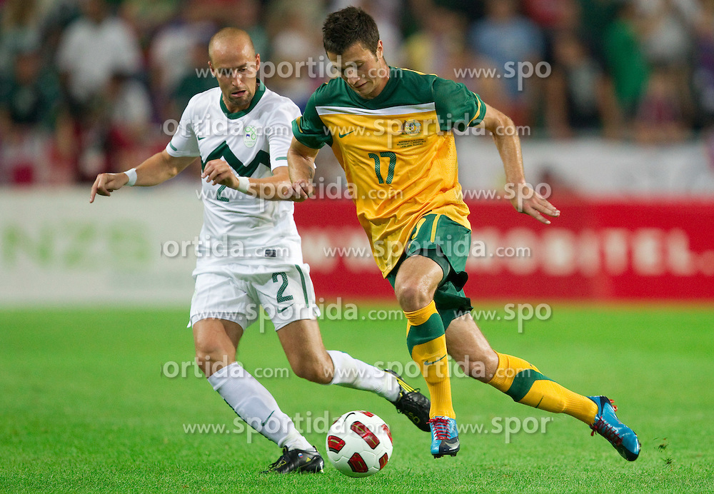 Miso Brecko of Slovenia vs Nathan Burns of Australia during the opening friendly football match at a new stadium in Stozice between National teams of Slovenia and Australia on August 11, 2010 in Ljubljana. Slovenia defeated Australia 2-0. (Photo by Vid Ponikvar / Sportida)