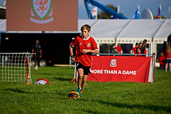 """NEWPORT, WALES - Thursday, August 30, 2018: A boy playing football at the FAW supporters' """"Fan Zone"""" before the FIFA Women's World Cup 2019 Qualifying Round Group 1 match between Wales and England at Rodney Parade. (Pic by Laura Malkin/Propaganda)"""
