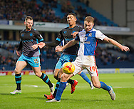 Chris Taylor of Blackburn Rovers (right) tries to bring the ball under control while being closed down by Liam Palmer of Sheffield Wednesday during the Sky Bet Championship match at Ewood Park, Blackburn<br /> Picture by Russell Hart/Focus Images Ltd 07791 688 420<br /> 28/11/2015