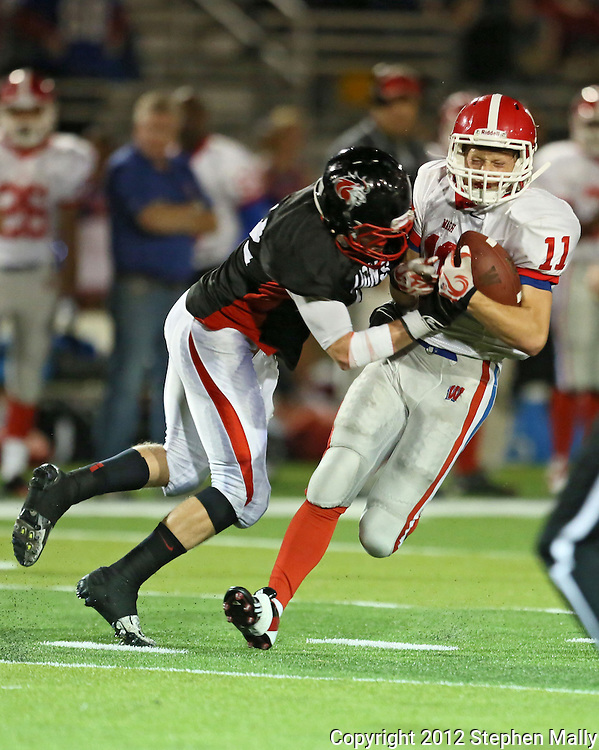 Linn-Mar's Zach Martins (22) hits Washington's Noah Dostal (11) after a catch during the second quarter of the game between Cedar Rapids Washington and Linn-Mar at Linn-Mar Stadium in Marion on Friday, September 14, 2012.