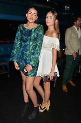 Left to right, CORA CORRE Vivienne Westwood's granddaughter and IZZY UTTERSON at a summer party hosted by Jo Wood & Yasmin Mills at Boujis, 43 Thurloe Street, London on 9th July 2014.