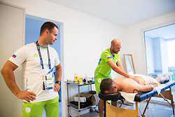 Dejan Fabcic watching as Primoz Jeralic of Slovenia having a physiotherapy session with physiotherapist Matej Kovac in the Paralympic Village 3 days ahead of the Rio 2016 Summer Paralympics Games on September 4, 2016 in Rio de Janeiro, Brazil. Photo by Vid Ponikvar / Sportida