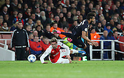 Arsenal defender Nacho Monreal getting a yellow card for this tackle during the Champions League match between Arsenal and Dinamo Zagreb at the Emirates Stadium, London, England on 24 November 2015. Photo by Matthew Redman.