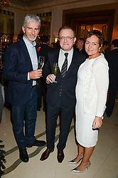 """Left to right, DAMON HILL, RICHARD GEOFFROY Dom Pérignon's Chef de Cave and GEORGIE HILL at an """"Evening With Damon Hill'  a dinner and talk in aid of the Downs Syndrome Association held at Claridge's, Brook Street, London on 7th November 2013."""
