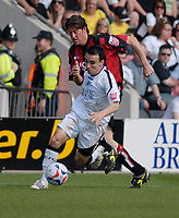 Photo: Leigh Quinnell.<br /> AFC Bournemouth v Swansea City. Coca Cola League 1. 14/04/2007. Swanseas Leon Britton gets away from Bournemouths Darren Anderton.