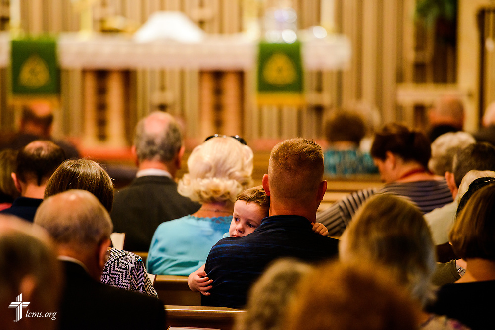 A child rests during Divine Service at Mt. Calvary Lutheran Church, La Grange, Texas, on Sunday, Sept. 3, 2017. Last week, only a handful of church members who weren't trapped by the floodwaters made it to worship. A week after Hurricane Harvey the pews filled up again after the waters receded. LCMS Communications/Erik M. Lunsford