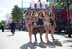 © Licensed to London News Pictures. 16/05/2012. London, UK. Models pose in Marks & Spencer's new lingerie line in honour of the Queen's jubilee year at photocall outside Marks & Spencer on Oxford Street, London on May 16, 2012. Photo credit : Ben Cawthra/LNP