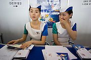 Seoul Motor Show 2005 at Korea International Exhibition Center (KINTEX). Shy lady at information counter.