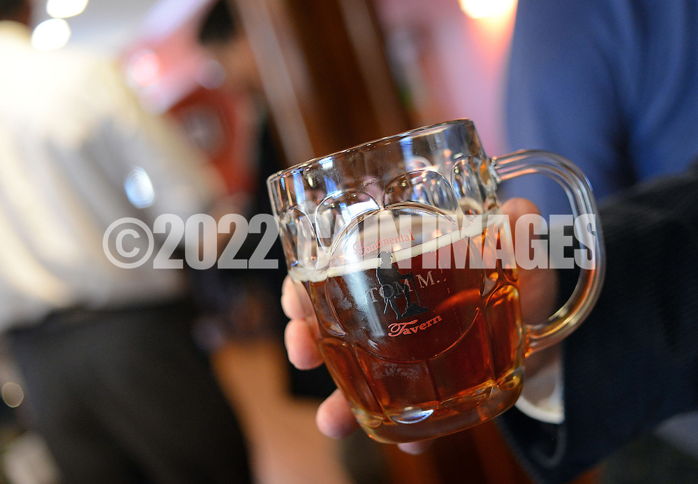 YARDLEY, PA -  MARCH 13: A participant hold a beer during a rally for liquor privatization March 13, 2014 at  Continental Tavern in Yardley, Pennsylvania. They assembled to raise a glass to our public servants in Harrisburg, and let them know we're ready to eliminate the last vestiges of Prohibition from Pennsylvania. (Photo by William Thomas Cain/Cain Images)