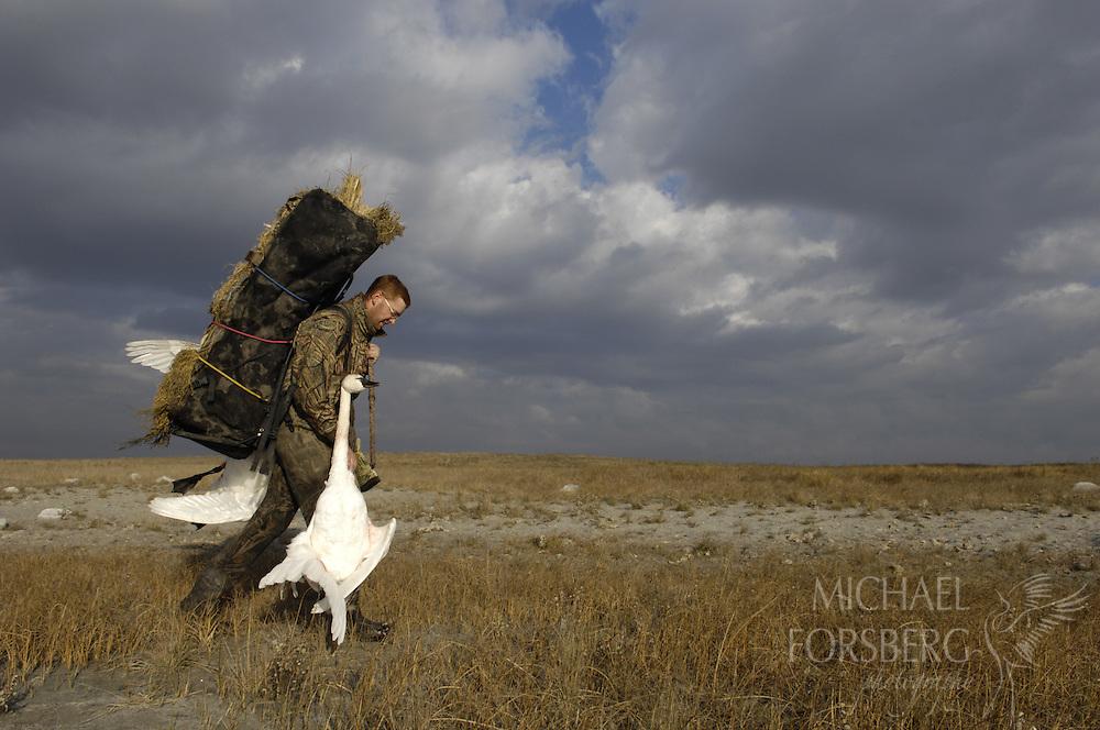 Prairie pothole region - Missouri coteau..Waterfowl hunters leave prairie pothole lake after successful day filling tundra swan tags..Kidder County North Dakota