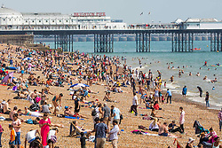 © Licensed to London News Pictures. 21/07/2016. Brighton, UK. Few people take to the beach in Brighton and Hove total advantage of the sunny and warm weather. Photo credit: Hugo Michiels/LNP