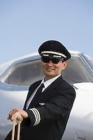 Portrait of Asian mid-adult pilot.