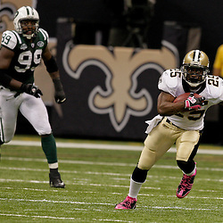 2009 October 04: New Orleans Saints running back Reggie Bush (25) runs with the ball during a 24-10 win by the New Orleans Saints over the New York Jets at the Louisiana Superdome in New Orleans, Louisiana.