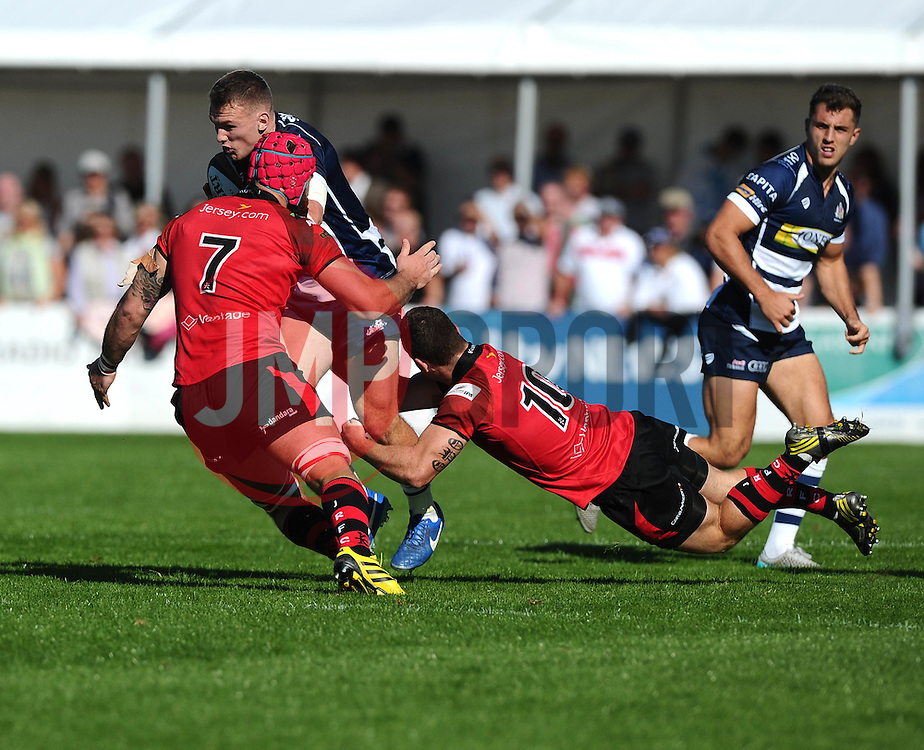 Brendan Cope of Jersey Rugby tackles Bristol Rugby Inside Centre Nick Carpenter  - Mandatory byline: Joe Meredith/JMP - 07966386802 - 26/09/2015 - RUGBY - St. Peter -Saint Peter,Jersey - Jersey Rugby v Bristol Rugby - Greene King IPA Championship