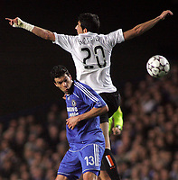 Photo: Paul Thomas.<br /> Chelsea v Valencia. UEFA Champions League. Quarter Final, 1st Leg. 04/04/2007.<br /> <br /> Michael Ballack (L) of Chelsea has Raul Albiol jump above him.