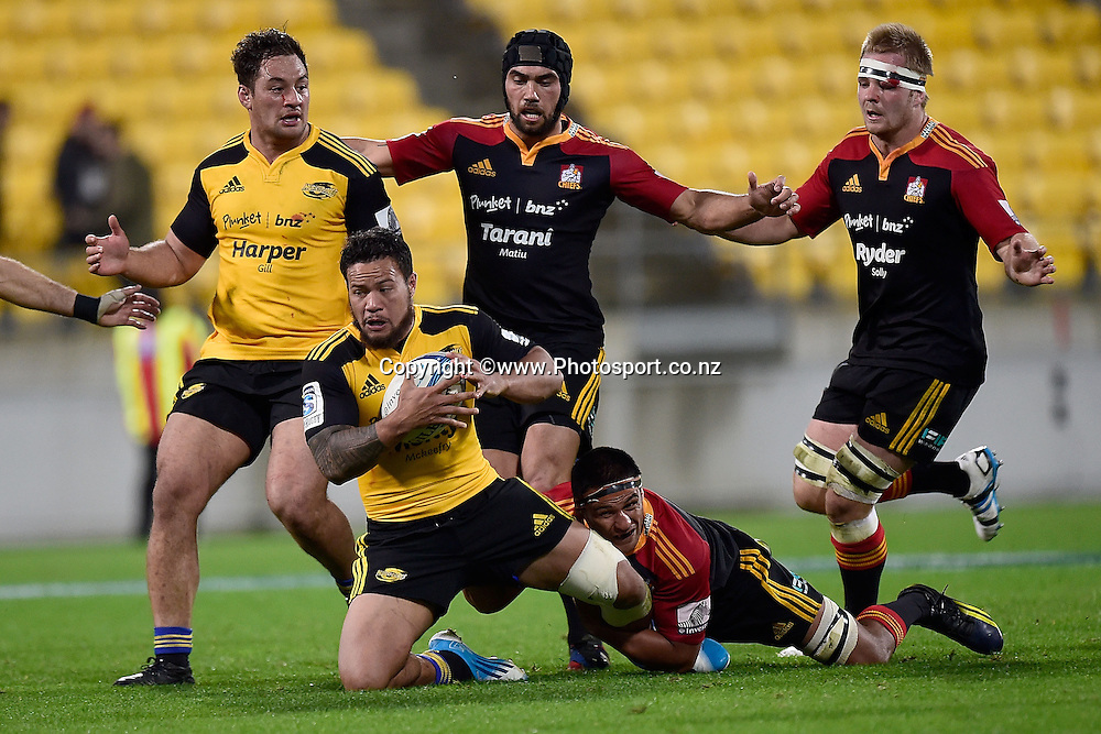 Alapati Leiua (Front C) of the Hurricanes is tackled by Tanerau Latimer of the Chiefs withe Chiefs Sam Cane (R and Ben Tameifuna (Back C) and Hurricanes' Jack Lam (Back L) in support during a Super Rugby - Hurricanes v Chiefs match at the Westpac Stadium in Wellington on Saturday the 24th of May 2014. Photo by Marty Melville/www.Photosport.co.nz