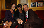 Tamara Mellon, Mohieb and Patrick Cox. charles Finch and Chanel 6th Anniversary Pre-Bafta party to celebratew A Great Year of Film and Fashion Beyond the Red Carpet at Annabel's. Berkeley Sq. London W1. 18 February 2006. ONE TIME USE ONLY - DO NOT ARCHIVE  © Copyright Photograph by Dafydd Jones 66 Stockwell Park Rd. London SW9 0DA Tel 020 7733 0108 www.dafjones.com