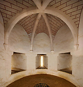 Guardroom or Salle de Garde on the first floor of the Chapel Tower, with arrow loops and Guedelon's first cross-ribbed vaulted ceiling, built in 2000, at the Chateau de Guedelon, a castle built since 1997 using only medieval materials and processes, photographed in 2017, in Treigny, Yonne, Burgundy, France. The Guedelon project was begun in 1997 by Michel Guyot, owner of the nearby Chateau de Saint-Fargeau, with architect Jacques Moulin. It is an educational and scientific project with the aim of understanding medieval building techniques and the chateau should be completed in the 2020s. Picture by Manuel Cohen