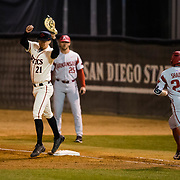 24 February 2018: The San Diego State Aztec baseball team competes in day two of the Tony Gwynn legacy tournament against #4 Arkansas. San Diego State Aztecs infielder Jordan Verdon (21) brings in a high throw for an out in the fourth inning. The Aztecs dropped a close game to the Razorbacks 4-2. <br /> More game action at sdsuaztecphotos.com