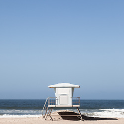 Photo of lifeguard tower along the Pacific Ocean in Huntington Beach Orange County Southern California.