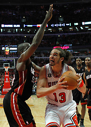 15.05.2011, UNITED CENTER, CHICAGO, USA, NBA, Chicago Bulls vs Miami Heat, im Bild Joakim Noah (R) goes to the basket against Miami Heat center Joel Anthony (L) in game 1 of the NBA Eastern Conference Championships at the United Center in Chicago, EXPA Pictures © 2011, PhotoCredit: EXPA/ Newspix/ KAMIL KRZACZYNSKI +++++ ATTENTION - FOR AUSTRIA/ AUT, SLOVENIA/ SLO, SERBIA/ SRB an CROATIA/ CRO, SWISS/ SUI and SWEDEN/ SWE CLIENT ONLY +++++