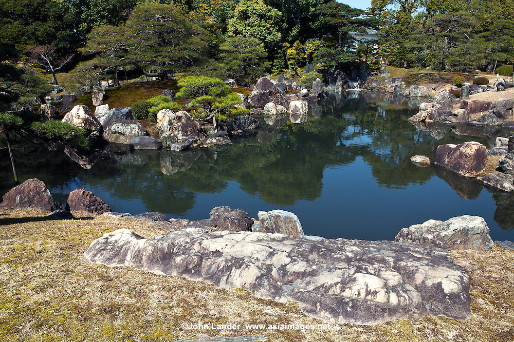 Ninomaru garden was designed by the landscape architect and garden designer Kobori Ensh and is located adjacent to Ninomaru Palace at Nijo Castle. The garden has a large pond with three islands and features carefully placed stones and pine trees.