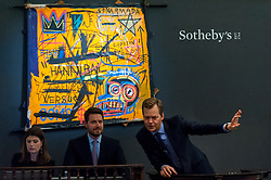 "© Licensed to London News Pictures. 07/10/2016. London, UK.   ""Hannibal"" by Jean-Michel Basquiat sold for a hammer price of £9.3m (est. £3.5-4.5m) at Sotheby's Italian and Contemporary Art evening sale in New Bond Street. Photo credit : Stephen Chung/LNP"