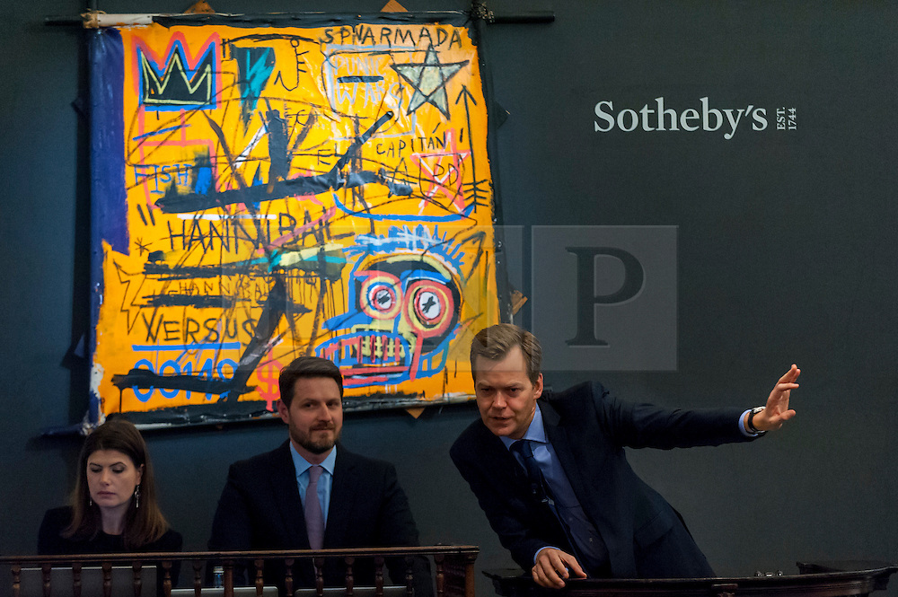 """© Licensed to London News Pictures. 07/10/2016. London, UK.   """"Hannibal"""" by Jean-Michel Basquiat sold for a hammer price of £9.3m (est. £3.5-4.5m) at Sotheby's Italian and Contemporary Art evening sale in New Bond Street. Photo credit : Stephen Chung/LNP"""