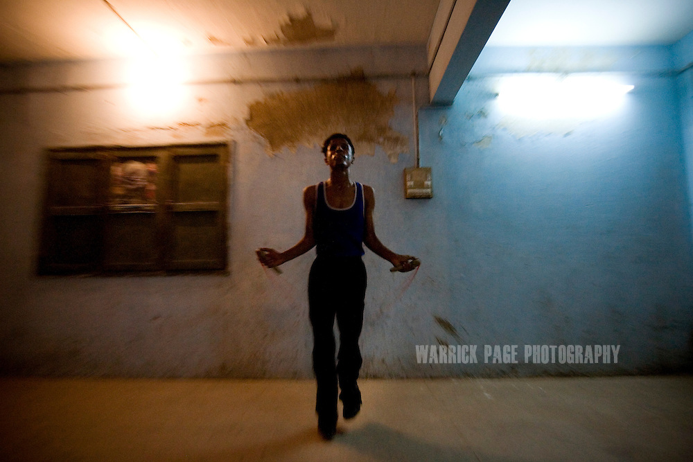 KARACHI, PAKISTAN - OCTOBER 12: A member of the Young Baloch Boxing Club jumps rope during a training session, Sunday, October 12, 2008, in Karachi, Pakistan. Lyari is Karachi's poorest, most dangerous, drug and crime-infested slum, but has produced the bulk of Pakistan's champion boxers. Boxing has been a way of survival for many of the young men, who are often sponsored by corporations and event the military, to box for them at events throughout the city and the country. Lacking in the most basic resources, including a sufficient diet, the young boxers have watched countless champions on television throughout the years, attempting to emulate their abilities. (Photo by Warrick Page)