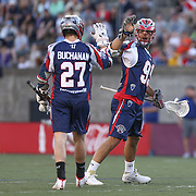 Paul Rabil #99 of the Boston Cannons celebrates a goal with Kevin Buchanan #27 of the Boston Cannons during the game at Harvard Stadium on May 17, 2014 in Boston, Massachuttes. (Photo by Elan Kawesch)