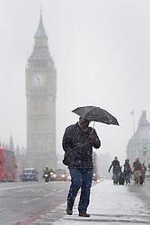 © licensed to London News Pictures. London, UK 18/01/2013. People walking on Westminster Bridge as snow hits London on Friday 18, January 2013. Photo credit: Tolga Akmen/LNP
