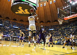 Feb 12, 2018; Morgantown, WV, USA; West Virginia Mountaineers forward Sagaba Konate (50) shoots a jumper while defended by TCU Horned Frogs forward Kouat Noi (12) during the second half at WVU Coliseum. Mandatory Credit: Ben Queen-USA TODAY Sports
