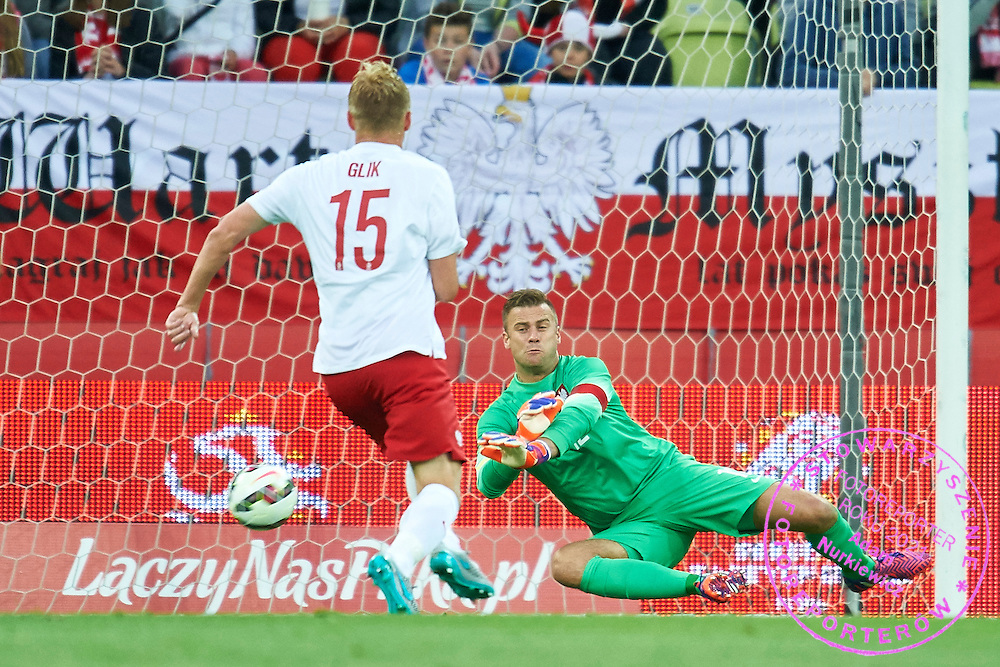 (R) Artur Boruc from Poland saves next to Kamil Glik from Poland during international friendly soccer match between Poland and Greece at PGE Arena Stadium on June 16, 2015 in Gdansk, Poland.<br /> Poland, Gdansk, June 16, 2015<br /> <br /> Picture also available in RAW (NEF) or TIFF format on special request.<br /> <br /> For editorial use only. Any commercial or promotional use requires permission.<br /> <br /> Adam Nurkiewicz declares that he has no rights to the image of people at the photographs of his authorship.<br /> <br /> Mandatory credit:<br /> Photo by &copy; Adam Nurkiewicz / Mediasport