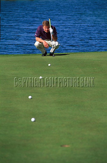 Simon Holmes putting drill using 4 tee pegs as markers<br /> Credit: Nick Walker/Golf Picture Bank
