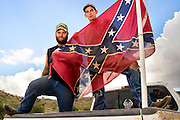 "Sonoita, Arizona, USA, 7th July, 2015:  Caleb Gates, 20, (left), and Ray Helton, 22, display the Confederate flag attached to the truck that Gates was driving in Sonoita, Arizona, USA.  About the flag Gates says, ""It is part of Southern heritage.  I think it means rebellion, not racism.  Some of my best friends are Black and Mexican"".  Helton says, ""I don't see it as racist"".  Controversy over the Confederate battle flag has escalated across the southern states after the killings at Emanuel African Methodist Episcopal Church in South Carolina."