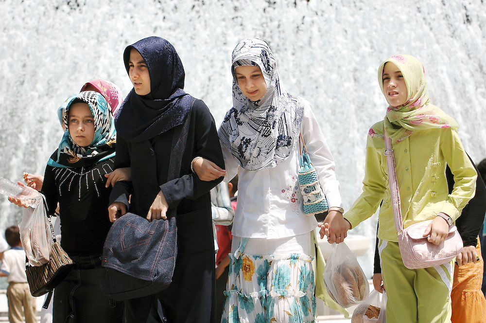 Istanbul, Turkey 06 July 2005<br /> Turkish girls walk in a popular square in Istanbul, close to the Eyup Mosque.<br /> Photo: Ezequiel Scagnetti
