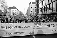 Germany, Frankfurt am Main :  Protesters hold a banner written 'Our time to act has come!' during a demonstration on the opening day of the European Central Bank (ECB) in Frankfurt am Main, western Germany, on March 18, 2015<br /> <br /> .