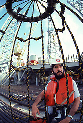 Stock photo of a personnel basket bringing offshore drilling rig crewman onboard.